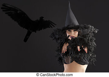 portrait of the young witch with scary pose