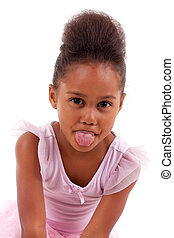 Cute little African Asian girl sticking tongue out, isolated...