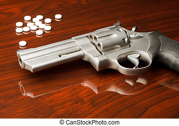 Revolver Pills - 357 pistol on wooden surface in front of...
