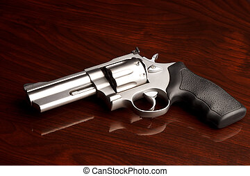 Revolver Table - Clean .357 revolver laying on reflective...
