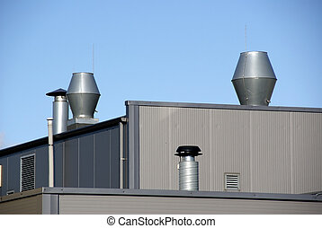 Ventilation - Pipes of ventilation are located on a roof of...