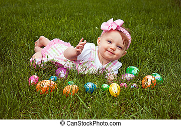 Easter Baby Smirk Lay - Beautiful baby laying in grass with...