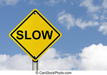 Go Slow - An American road warning sign with sky background...
