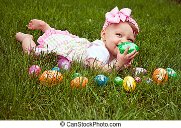 Easter Baby Hold Egg Lay - Baby girl laying in the grass...