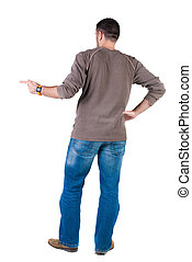 young man pointing at wall rear view Isolated over white