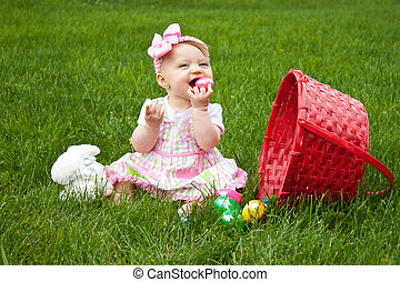 Easter Baby Spill Eat - Baby Smiling while holding an Easter...