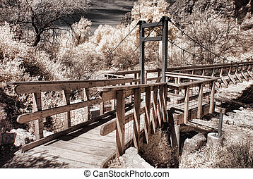 Footbridge - Old style suspended footbridge over a dry river