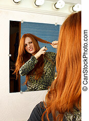 Cut Hair Mirror - Beautiful red head woman uneasy about...