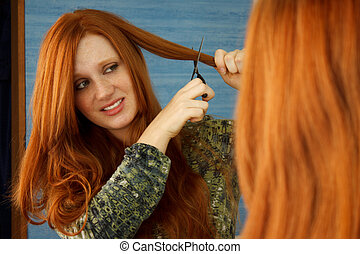 Cut Hair Close - Pretty red head girl nervously cutting hair...