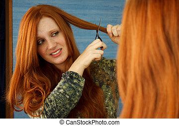 Cut Hair Close - Pretty red head girl nervously cutting hair...