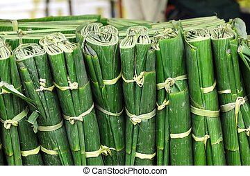 wrapped banana leaves - background of wrapped banana leaves...