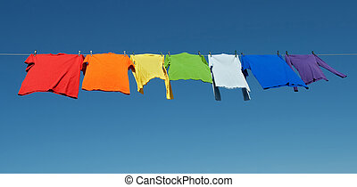 Rainbow laundry, bright shirts on a clothesline - Rainbow...