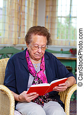 seniors sitting in a chair - a senior is sitting in an...