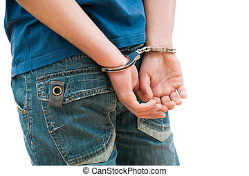 Young man in handcuffs.  Rear view