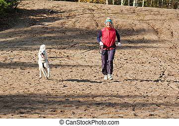 The sports woman with a dog