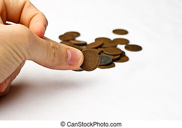 Wheat Pennies Pinch - Person pinching a wheat penny in front...