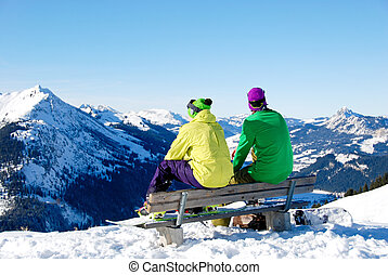 Two Man Sitting On Bench In Winter