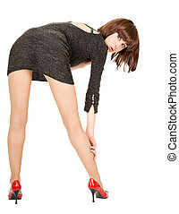 fashionista in a short dress in a tilted position on a white...