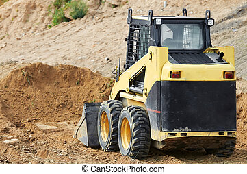 skid steer loader at earth moving works - skid steer loader...