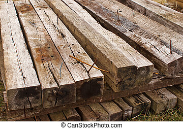 Railroad Ties Top Front - Stacked long railroad ties in an...