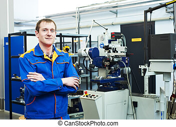 worker at tool workshop - mechanical technician near milling...