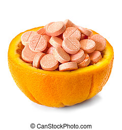 Vitamin C tablets piled in half an orange, isolated on white...