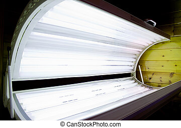 Tanning Bed Open - Open tanning bed with lit white bulbs