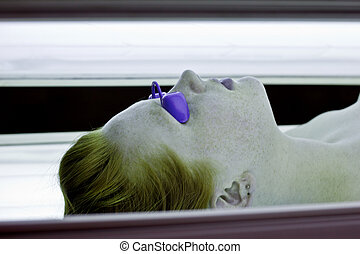 Tanning Bed Red Head - Red haired young woman wearing...