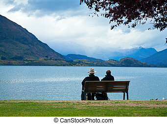 View of Lake Wanaka - Couple enjoying the view of Lake...