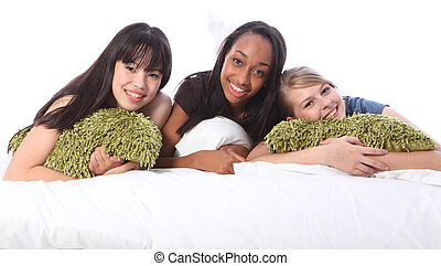 Mixed race teenage girl friends at slumber party - Slumber...