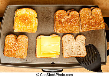 Cooking Grilled Cheese - Five grilled cheese sandwiches...
