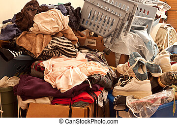 Clutter - Pile of misc items stored in an unorganized...