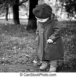 Little child discovering the world in autumn park