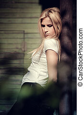 Though the leafs - Young woman portrait shot though the...