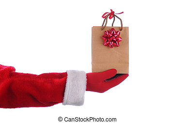 Santa with gift bag - Santa Claus outstretched arm with a...