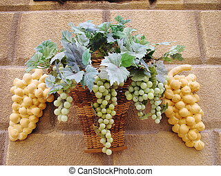 bunches of green true grapes and two pieces of bread with...
