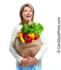 Shopping woman. - Senior shopping woman with grocery items ....