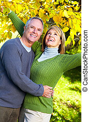 Elderly couple - Happy senior couple in love at the park