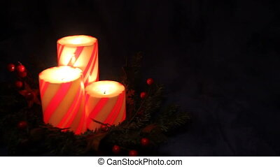 christmas pillar candles - three Christmas pillar candles...
