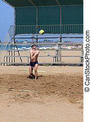 Man playing volleyball on the beach