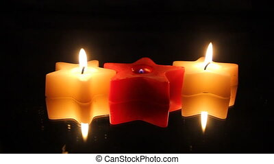 Christmas star candle row - Three star shaped candles in a...