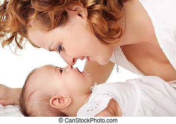 Mom playing with her cute baby girl - Closeup of loving...