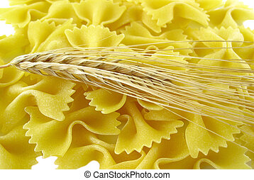 Pasta and ear of wheat - Ear of wheat on a pasta background...