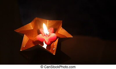 red floating Christmas star candle - rusty, star shaped tin...