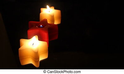 three Christmas star candles - Three star shaped candles in...