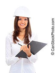 Smiling young female architect holding blueprints isolated...