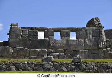 Ancient Inca Temple on Machu Picchu with Blue Sky in the...