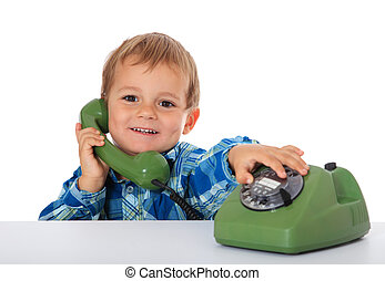 Phone call - Cute caucasian boy using telephone. All on...