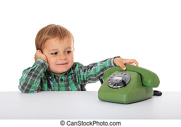 Boy awaits a phone call