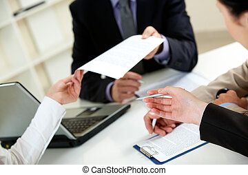 Important document - Businessman giving document to his...